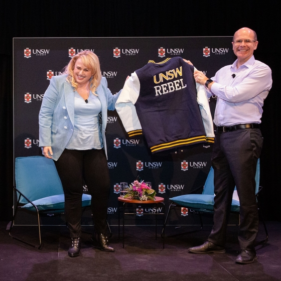 Rebel Wilson holding a UNSW Jacket
